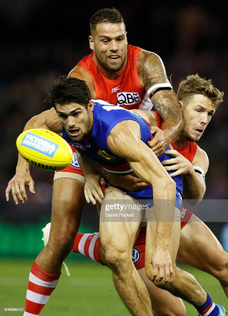 Easton Wood of the Bulldogs, Lance Franklin of the Swans and Luke Parker of the Swans contest the ball during the round four AFL match between the Western Bulldogs and the Sydney Swans at Etihad Stadium on April 14, 2018 in Melbourne, Australia.