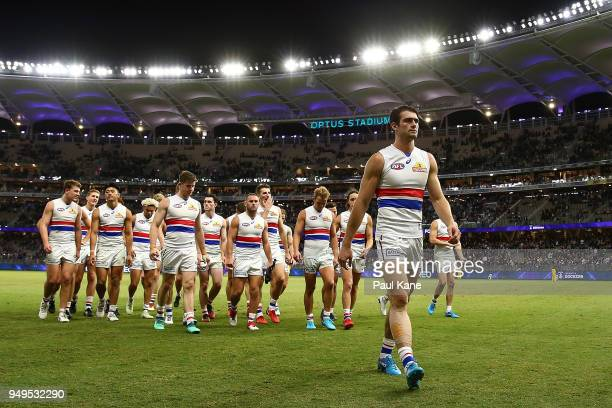 Easton Wood of the Bulldogs leads the team from the field after being defeated during the round five AFL match between the Fremantle Dockers and the...