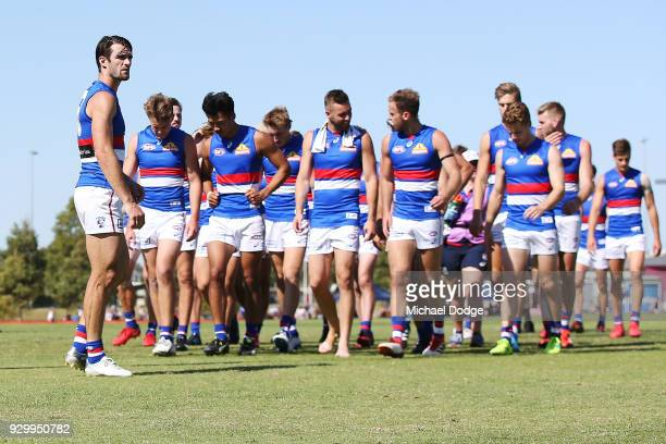 Easton Wood of the Bulldogs looks dejected as he leads the team off after defeat during the JLT Community Series AFL match between Collingwood...