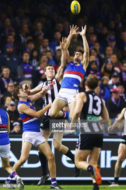 Easton Wood of the Bulldogs marks the ball against Mason Cox of the Magpies during the round 10 AFL match between the Collingwood Magpies and the...