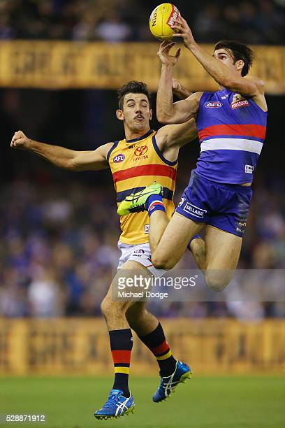 Easton Wood of the Bulldogs marks the ball against Taylor Walker of the Crows during the round seven AFL match between the Western Bulldogs and the...