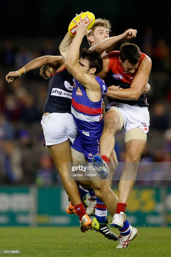 Easton Wood of the Bulldogs marks the ball during the round 15 AFL match between the Western Bulldogs and the Melbourne Demons at Etihad Stadium on June 29, 2014 in Melbourne, Australia.