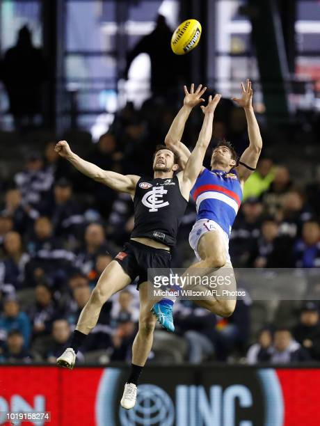 Easton Wood of the Bulldogs marks the ball over Darcy Lang of the Blues during the 2018 AFL round 22 match between the Carlton Blues and the Western...