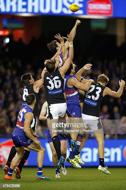Easton Wood of the Bulldogs punches the ball clear of a large pack during the round 14 AFL match between the Western Bulldogs and the Carlton Blues...