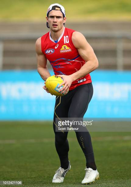 Easton Wood of the Bulldogs runs with the ball during a Western Bulldogs AFL training session at Whitten Oval on August 7 2018 in Melbourne Australia