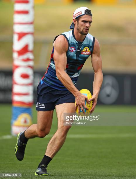 Easton Wood of the Bulldogs runs with the ball during the Western Bulldogs AFL training session at Whitten Oval on March 19, 2019 in Melbourne,...
