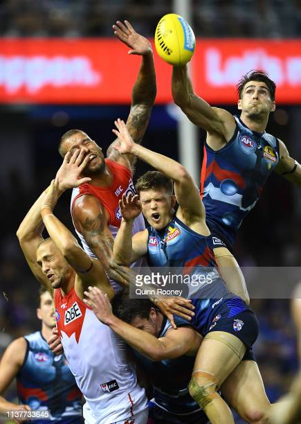 Easton Wood of the Bulldogs spoils a mark by Lance Franklin of the Swans during the round one AFL match between the Western Bulldogs and the Sydney...