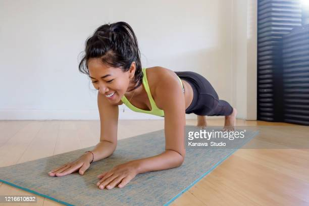 easy home quarantine workout - plank position stock pictures, royalty-free photos & images