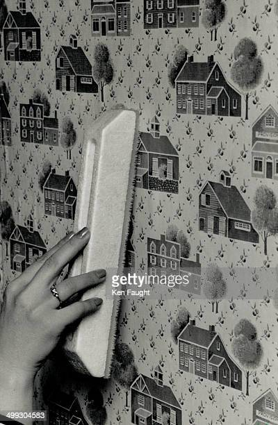 Easy steps Nancy Douglas of Color Your World demonstrates some wallpapering steps left to right Read instructions roll aper inside out use the proper...