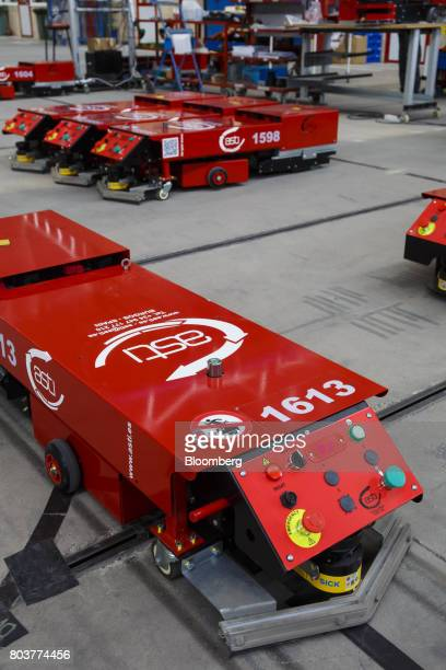 'Easybot' mobile robots also known as an AGV or automated guided vehicle sit during testing inside the Automatismos y Sistemas de Transporte Interno...