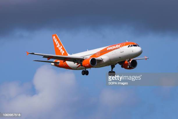 AIRPORT AMSTERDAM NETHERLANDS easyJet Airbus A320200 with registration GEZUS seen landing at the Amsterdam Schiphol Airport in Netherlands