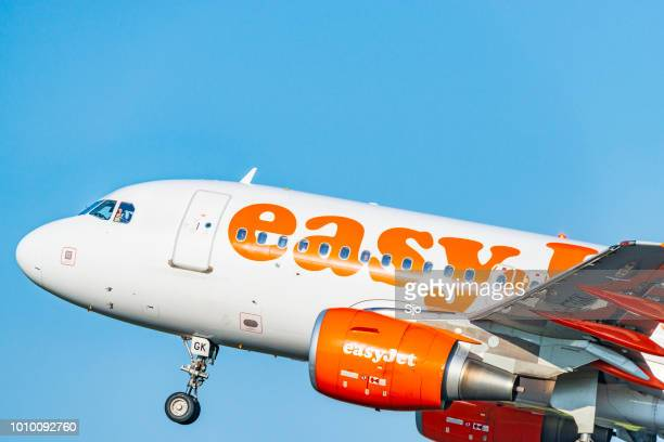 easyjet airbus taking off from amsterdam airport schiphol - easyjet stock pictures, royalty-free photos & images