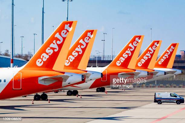 EasyJet aircrafts parked at an empty Schiphol Airport Closed gates and departure halls at Schiphol airport during times of the coronavirus threats...