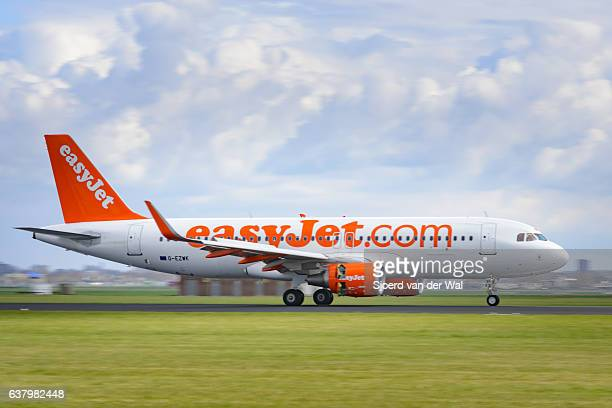 """easyjet airline airbus a319 airplane landing at the airfield - """"sjoerd van der wal"""" stock pictures, royalty-free photos & images"""