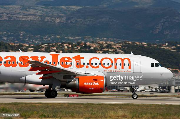 easyjet airplane on airport runway - easyjet stock pictures, royalty-free photos & images