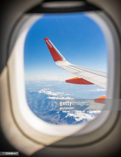 easyjet branding seen through the window - airbus stock pictures, royalty-free photos & images