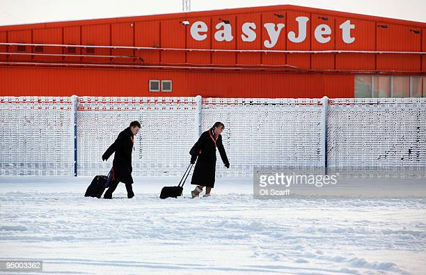 Easyjet cabin crew make their way through the snow to the terminal building of Luton airport on December 22 2009 in Luton England Adverse weather...