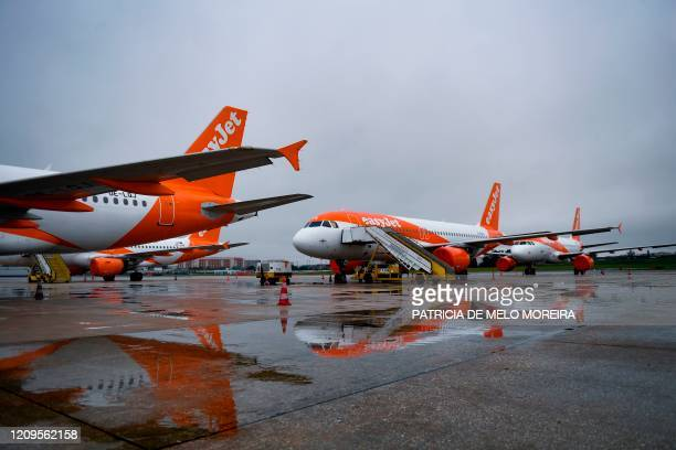 EasyJet lowcost airline aircrafts with their engines covered with plastic protection remain on the tarmac of the Humberto Delgado airport in Lisbon...