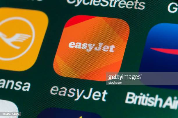 easyjet, lufthansa, british airways and other apps on iphone screen - easyjet stock pictures, royalty-free photos & images