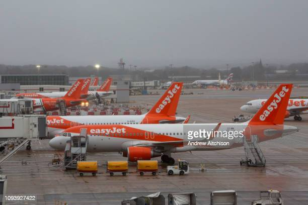EasyJet Planes including an Airbus A320214 line up at the North terminal gates inside Gatwick Airport Gatwick Airport Surrey United Kingdom