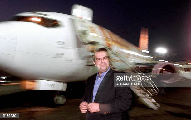 EasyJet tycoon Stelios HajiIoannou smiles in front of one of his jets 19 September 2000 on the tarmac at Athens international airport The low budget...