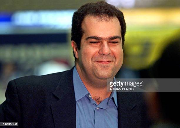 EasyJet tycoon Stelios HajiIoannou smiles while waiting to board the late EasyJet flight from Athens to London 19 September 2000 at Athens...