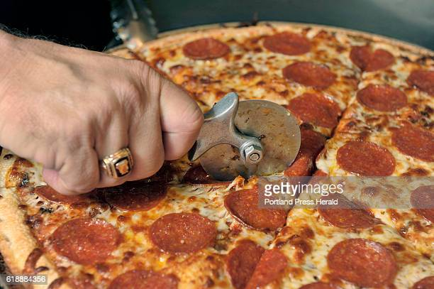 Eat and Run of Bill's Pizza on Commercial Street in Portland A fresh from the oven pepperoni pizza is cut into slices