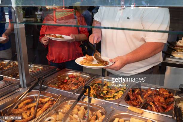 Eat as much as you like hot buffet at a Chinese restaurant in Chinatown in London, England, United Kingdom. Many people eat bargain food responsibly...