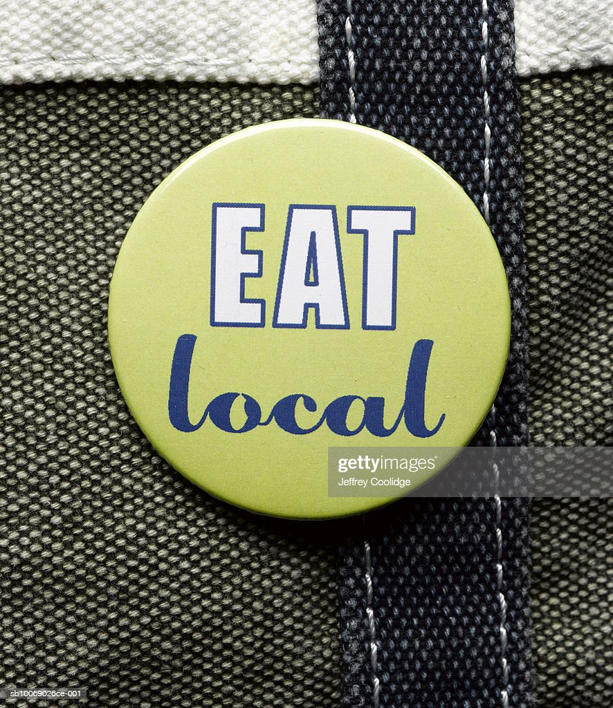 eat local button closeup ストックフォト getty images