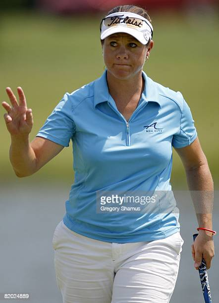 J Eathorne from Canada waves to fans after a birdie on the 17th hole during the first round of the State Farm Classic at Panther Creek Country Club...