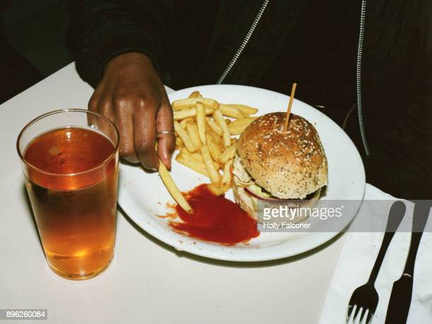 Eating a burger and chips, London