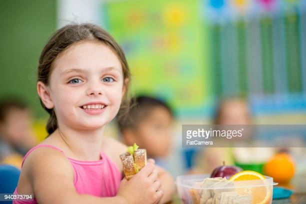 eating a sandwich - kid girl eating apple stock photos and pictures