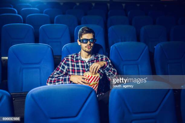 eating a snack while watching a movie - blue film video stock photos and pictures