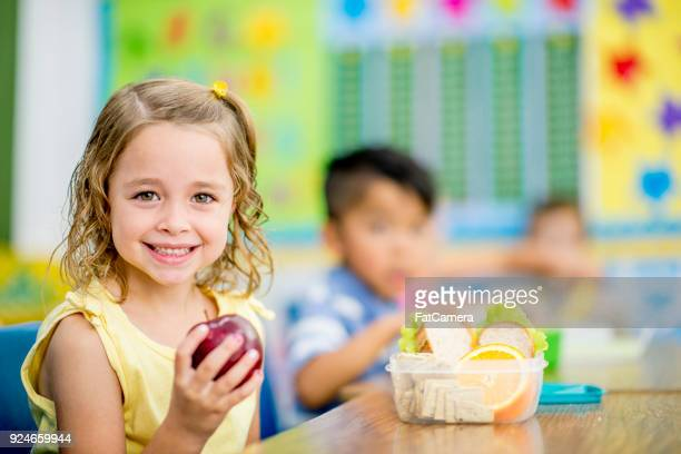 eating an apple - snack stock pictures, royalty-free photos & images
