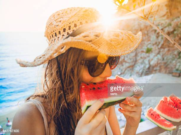 eating and enjoying watermelon - watermelon stock pictures, royalty-free photos & images