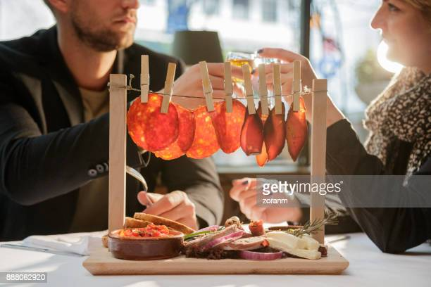 Eating appatizer in restaurant