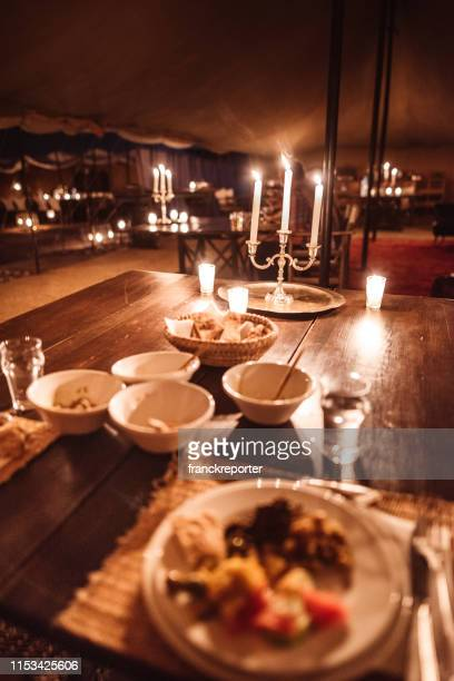 eating at candle light in a tent - night safari stock pictures, royalty-free photos & images