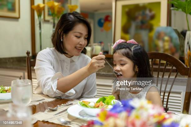 eating at home. - filipino family eating stock pictures, royalty-free photos & images