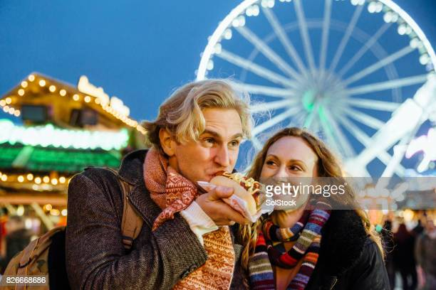 eating at the christmas fair - hyde park london stock photos and pictures
