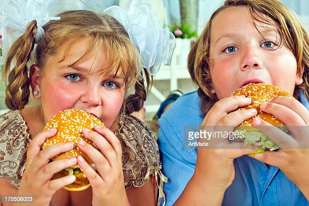eating burgers - chubby boy stock photos and pictures