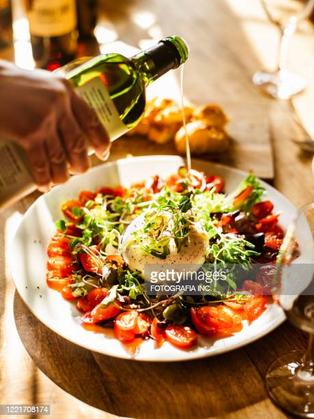 eating burrata italian style lunch - italian food stock pictures, royalty-free photos & images