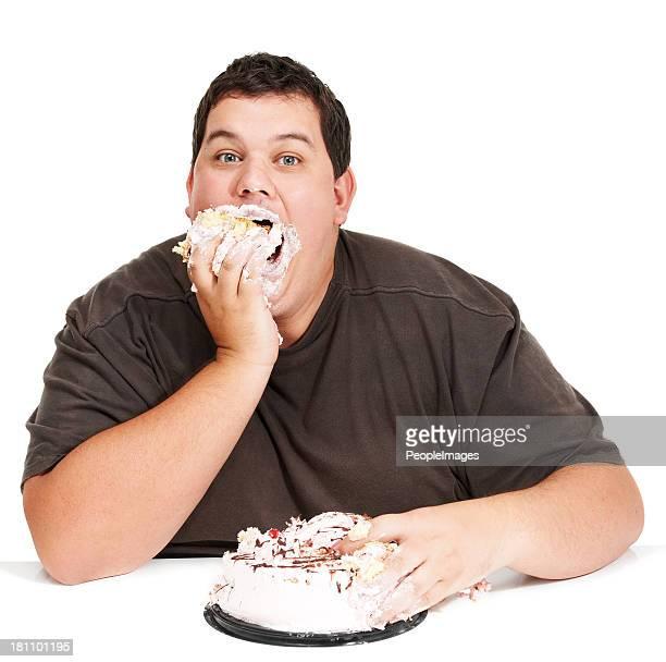 comer bolo em tempo recorde!! - sentar se imagens e fotografias de stock