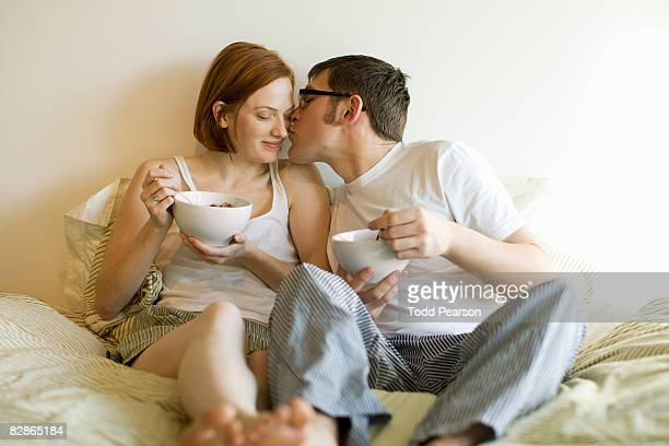 eating cereal in bed - ナイトウェア ストックフォトと画像