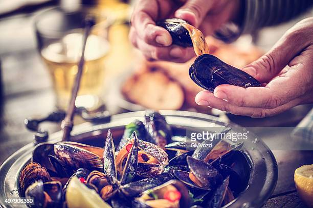 Eating Classic French Mussels Dish