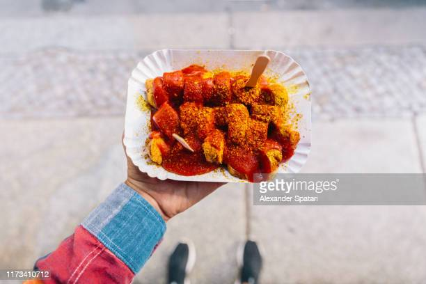 eating currywurst from personal perspective point of view - curry meal stock pictures, royalty-free photos & images