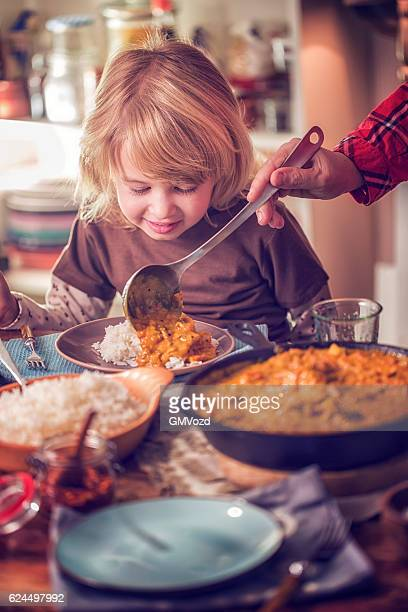 eating delicous homemade chicken curry dish with rice - chicken masala stock photos and pictures