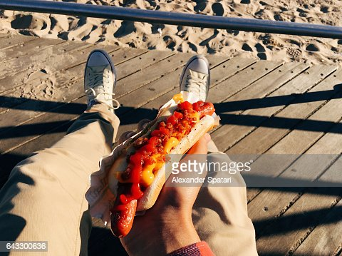 Eating famous New York hot dog at Coney Island Boardwalk, personal perspective