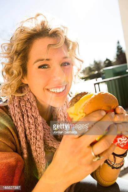 Eating fast food hamburgers