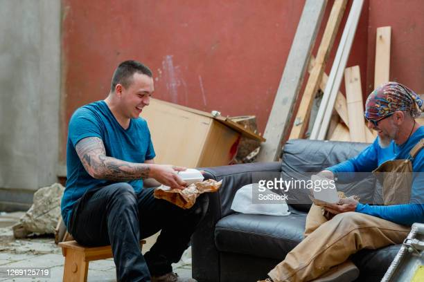 eating fish and chips together - charity benefit stock pictures, royalty-free photos & images