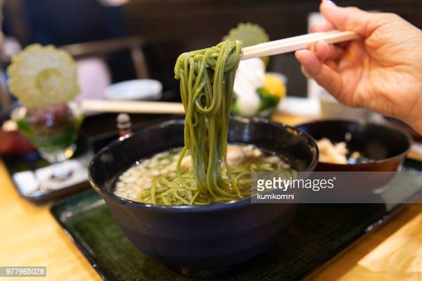 Eating green tea soba